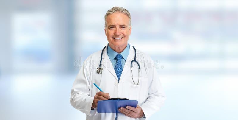 Scrittura del medico sui appunti fotografia stock