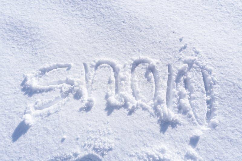 Scrittura del testo della neve immagini stock
