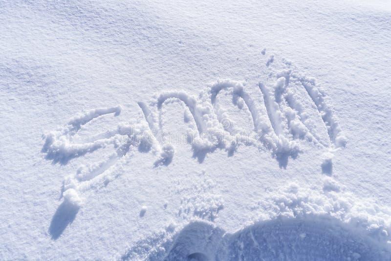Scrittura del testo della neve fotografie stock libere da diritti
