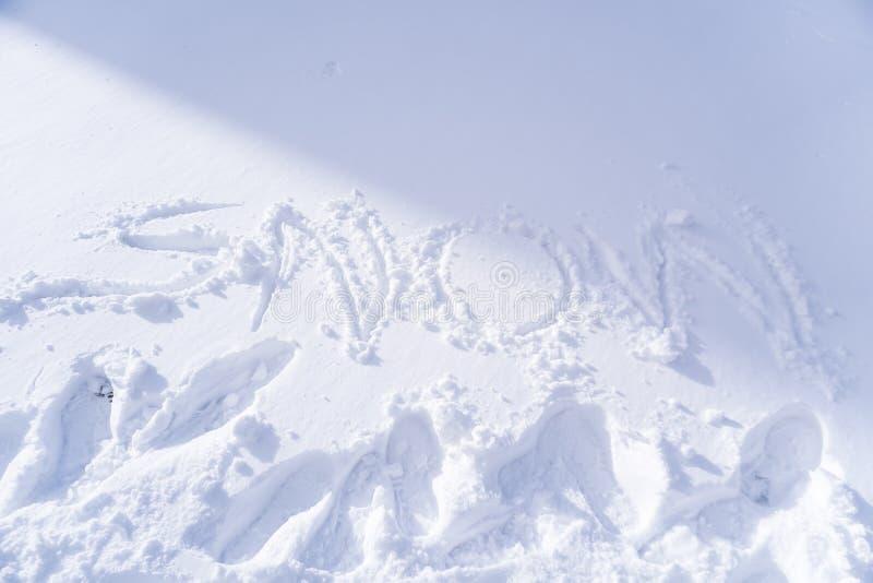 Scrittura del testo della neve immagine stock libera da diritti