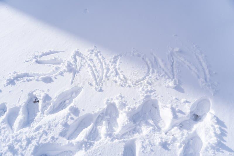 Scrittura del testo della neve fotografia stock
