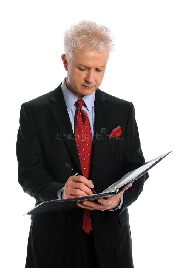 Scrittura dell'uomo d'affari immagine stock