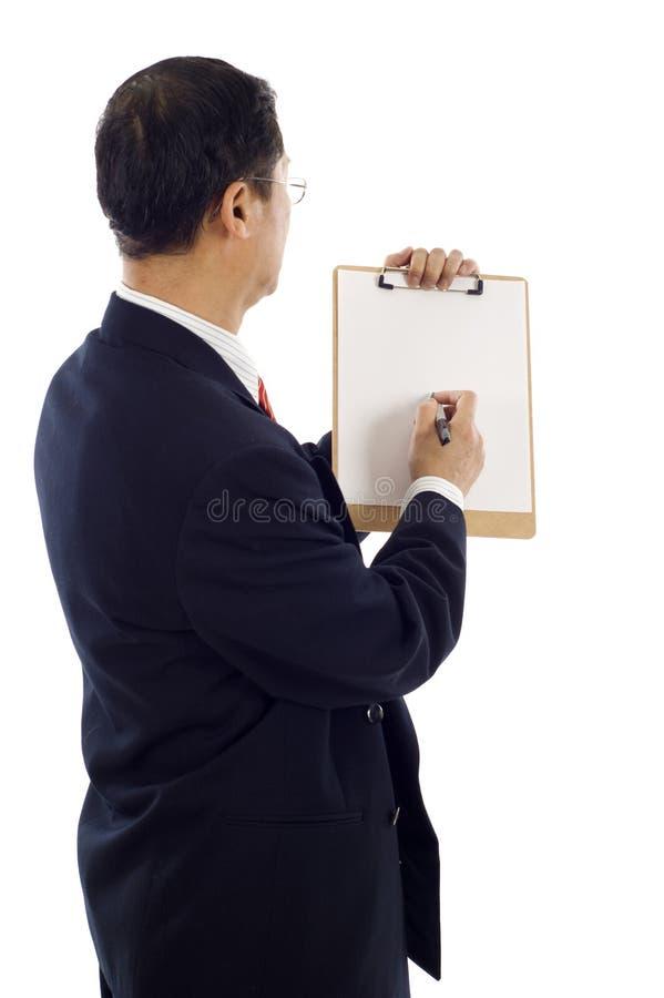 Scrittura dell'uomo di affari fotografia stock