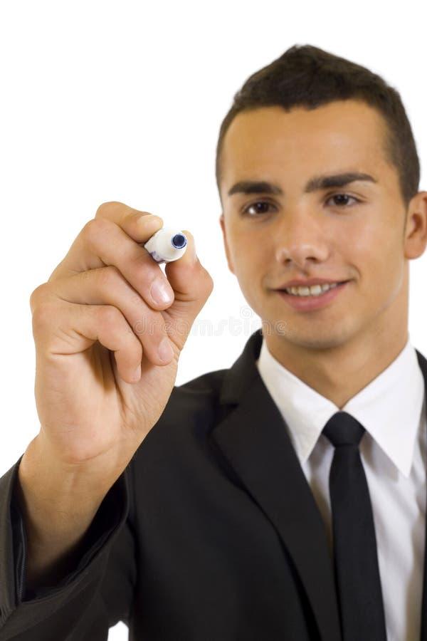 Scrittura dell'uomo di affari con l'indicatore fotografia stock