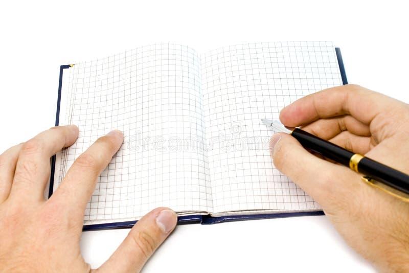 Scrittura della mano su un taccuino fotografie stock