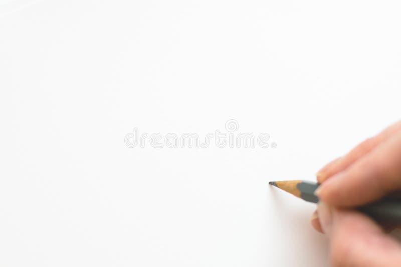 Scrittura della mano sul Libro Bianco immagini stock