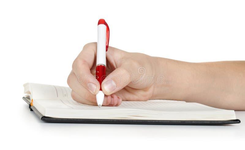 Scrittura della mano in taccuino immagine stock libera da diritti