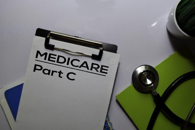 Scrittura della parte C Medicare su fondo bianco documento concetto medico-sanitario immagini stock