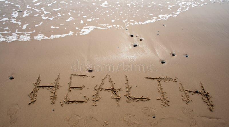 Scrittura della sabbia - SALUTE fotografia stock libera da diritti
