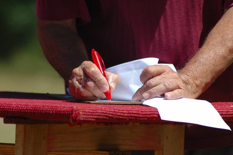 Scrittura delle mani immagine stock