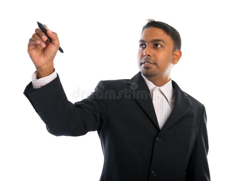 Scrittura indiana dell'uomo d'affari immagini stock