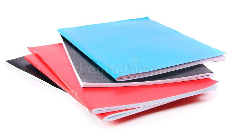 Scrittura-libri della scuola su fondo bianco immagini stock