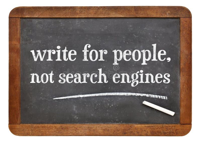 Scriva per la gente, non il motore di ricerca - lavagna fotografia stock libera da diritti