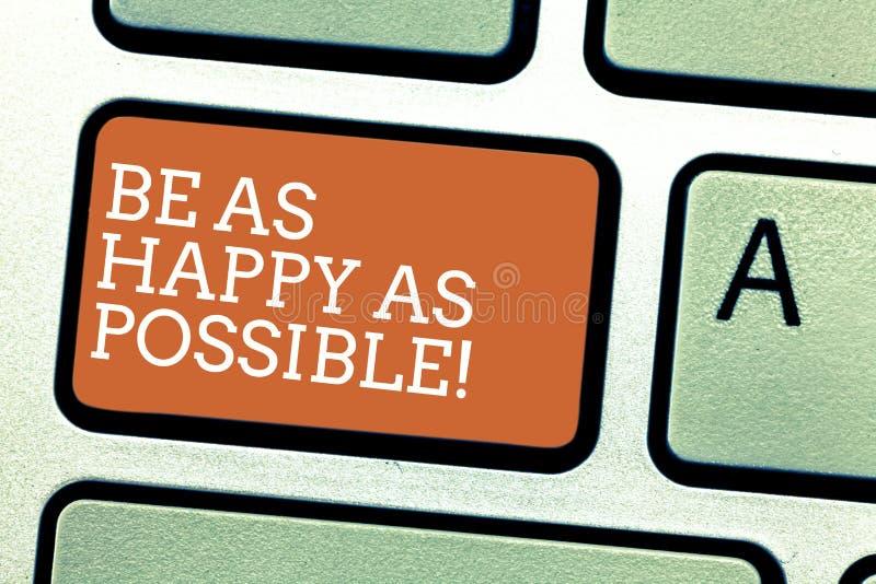 Scrivendo la rappresentazione della nota sia felice quanto possibile La foto di affari che montra il soggiorno ha motivato la fel immagine stock