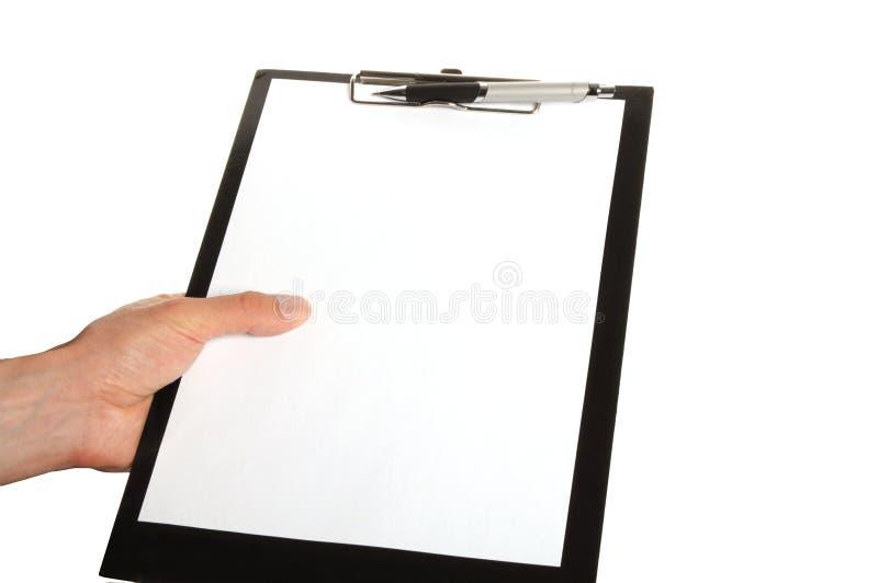 Scrivendo una nota su una lavagna per appunti fotografia stock libera da diritti