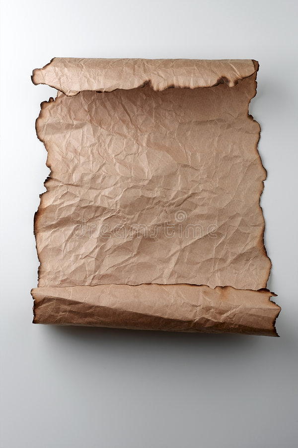 Scroll. Crumpled scroll with burned edges stock photography