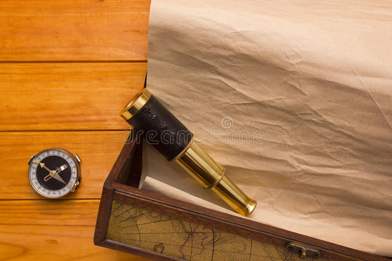 Scroll in the box, telescope and compass stock photography
