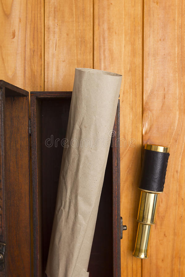 Scroll and telescope in the old box stock images