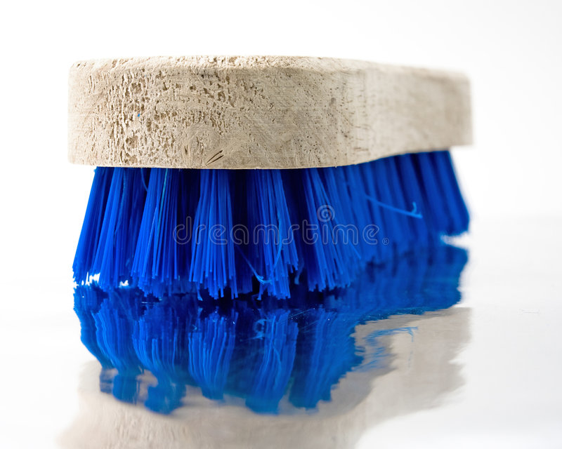 Scrub. Wooden scrub brush with reflection royalty free stock photography