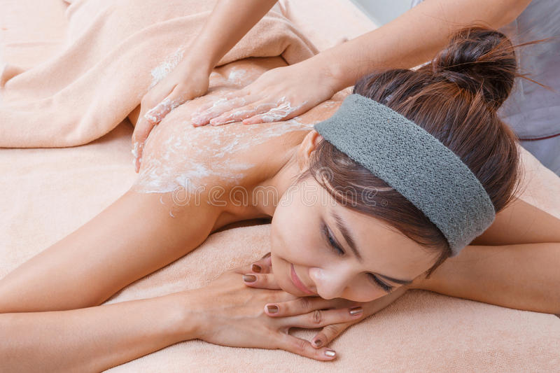 Scrub massage in Thai spa royalty free stock image