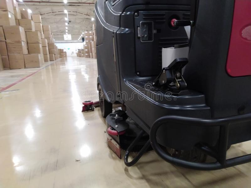 Scrubber drier for cleaning storage facilities.  Close-up.Floor polisher.Floor cleaning machine. Floor maintenance. Scrubber, drier, cleaning, storage stock photo