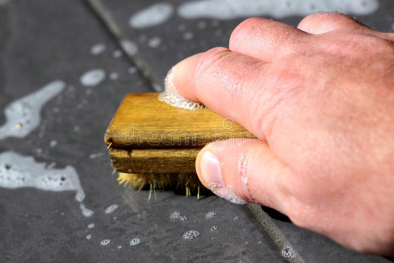 Scrubbing Floor Tiles Stock Images