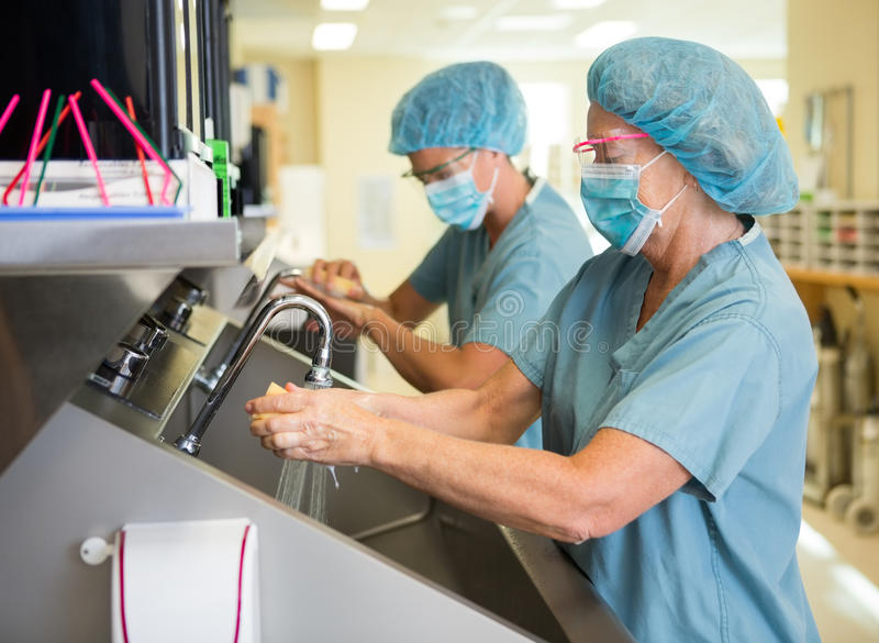 Scrubbing Hands And Arms Before Surgery Royalty Free Stock