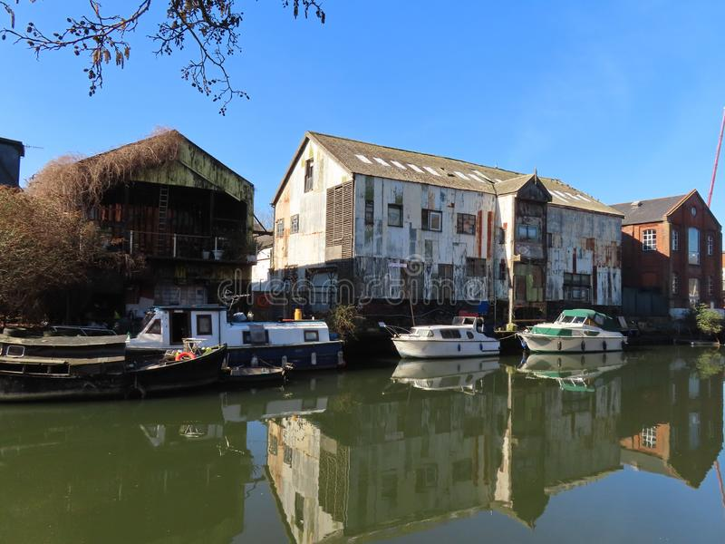 Disused Warehouse in Norwich and its reflection. A scruffy near derelict warehouse along the river Yare in Norwich royalty free stock photos