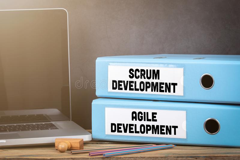 Scrum and Agile Development. Binders on desk in the office stock photo