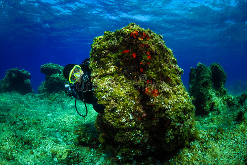 Scuba diver on the bottom of sea with water surface. stock image