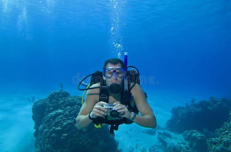 Scuba diver with camera, Cozumel, Mexico stock photos