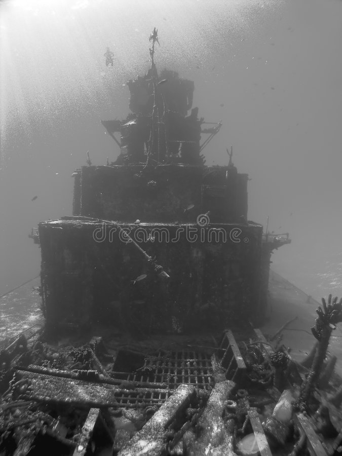 Scuba Diver descends on a Sunken Ship. In Black and White royalty free stock images
