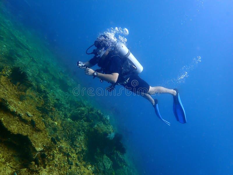 A scuba diver enjoy underwater dive in Tunku Abdul Rahman Park, Kota Kinabalu. Sabah, Malaysia. Borneo. A scuba diver enjoy a leisure dive in Tunku Abdul Rahman royalty free stock images