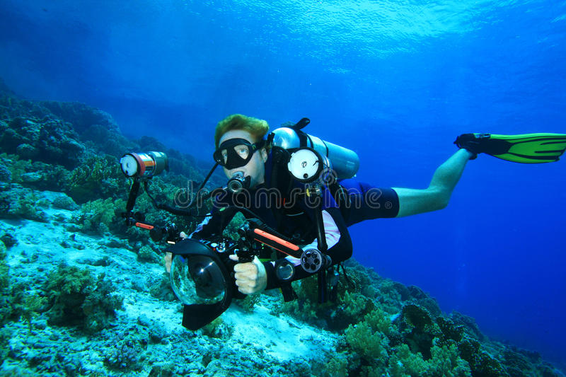 Download Scuba Diver Explores Coral Reef With His Camera Stock Image - Image: 14313195