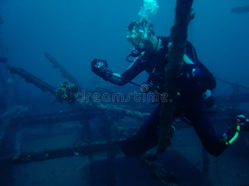 scuba diver photographing Frog fish Philippines stock photography