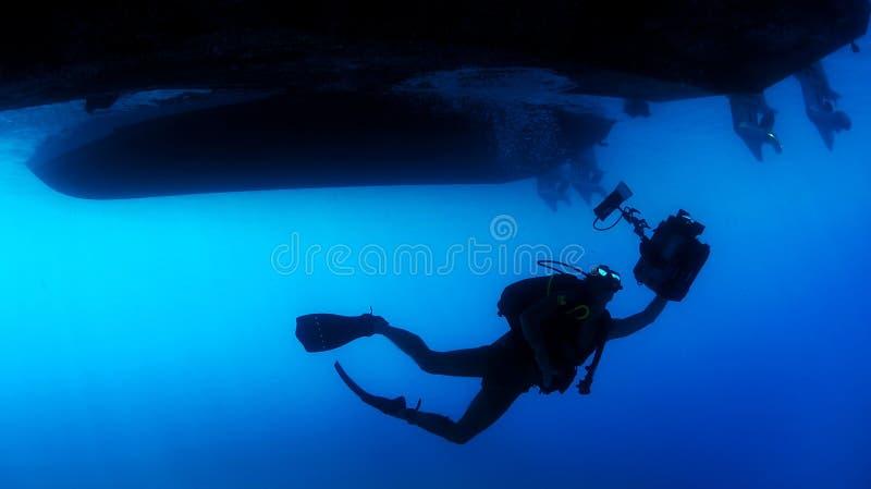 Scuba diver under ship royalty free stock photography