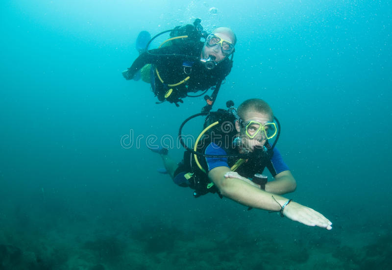 Scuba diver using compass royalty free stock image