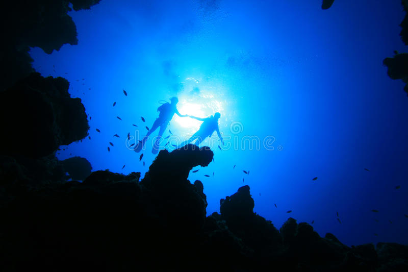 Scuba Divers and Canyon stock photography