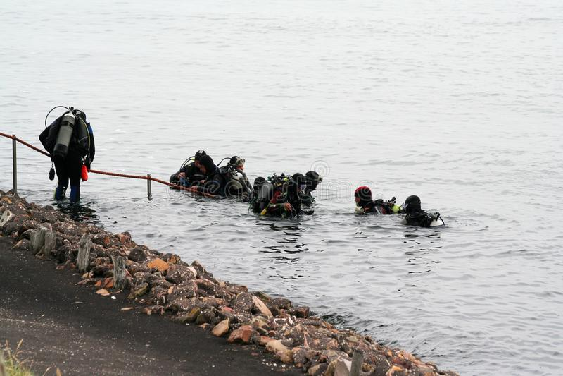 Scuba divers in Eastern Scheldt stock image