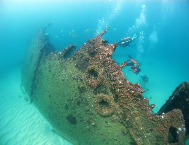 Scuba divers explore a wreck in the Indian Ocean stock photo