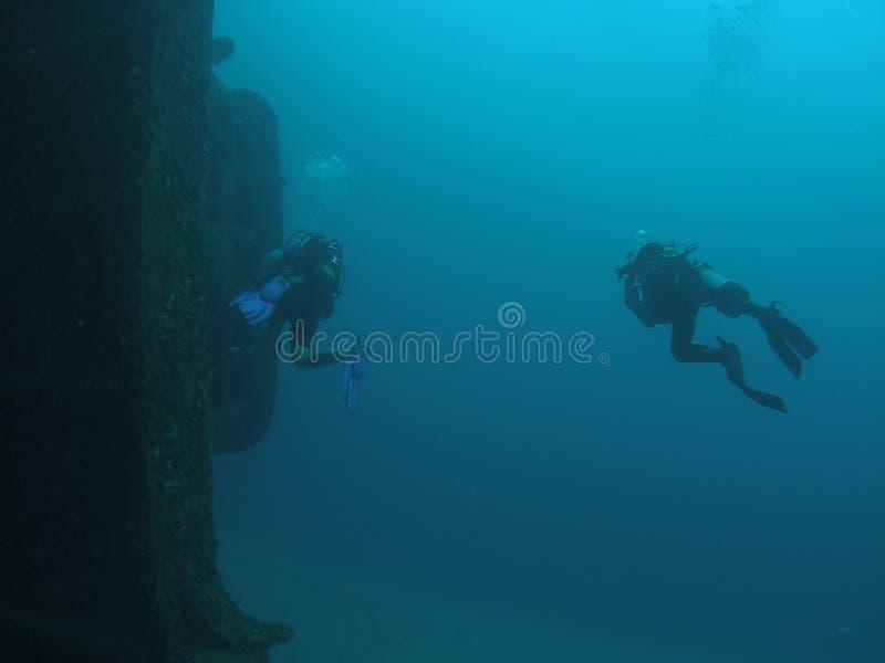 Scuba Divers and a ship wreck stock photos
