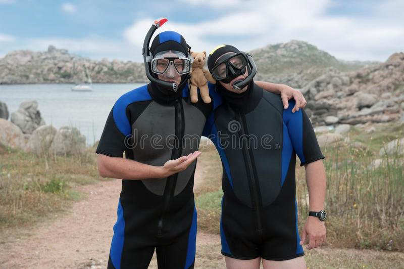 Download Scuba Divers With Teddy Bear Stock Image - Image of model, corsica: 15446553