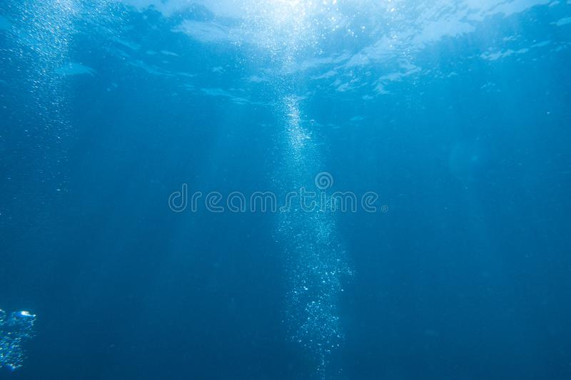 Scuba Diving bubbles with sun and rays royalty free stock image