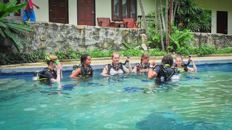 Scuba diving class in pool. Ban's diving resort-CDC center. KOH TAO, THAILAND - 26. MARCH 2018. Scuba diving class in pool. Open water course. Ban' royalty free stock photography