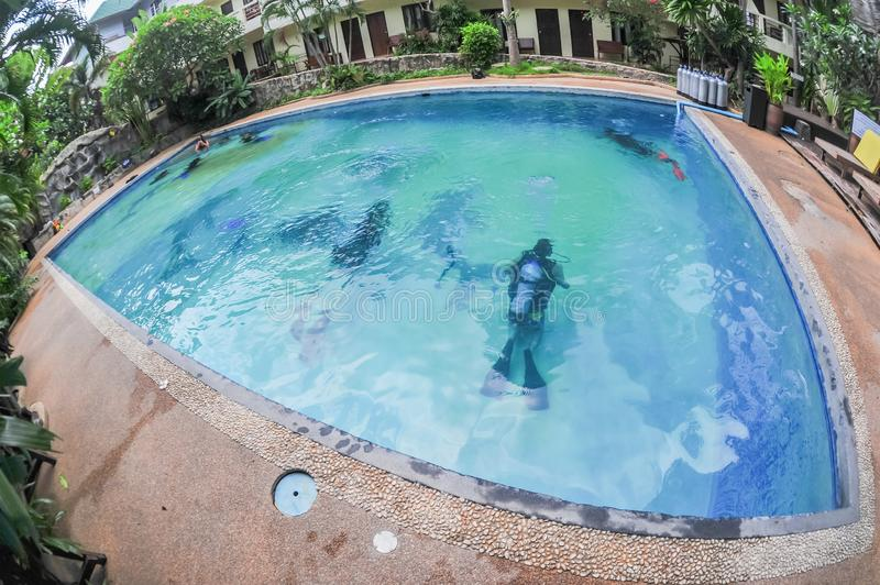 Scuba diving class in pool. Ban's diving resort-CDC center. KOH TAO, THAILAND - 26. MARCH 2018. Scuba diving class in pool. Open water course. Ban' stock photography