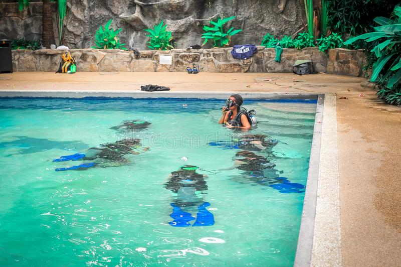 Scuba diving class in pool. Ban's diving resort-CDC center. KOH TAO, THAILAND - 26. MARCH 2018. Scuba diving class in pool. Open water course. Ban' stock images
