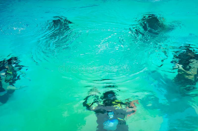 Scuba diving class in pool. Ban's diving resort-CDC center. KOH TAO, THAILAND - 26. MARCH 2018. Scuba diving class in pool. Open water course. Ban' royalty free stock image