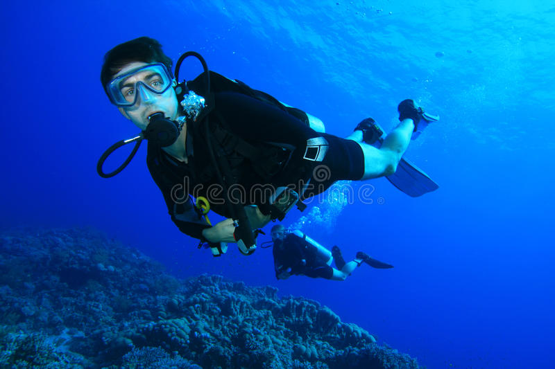 Scuba diving on coral reef stock images