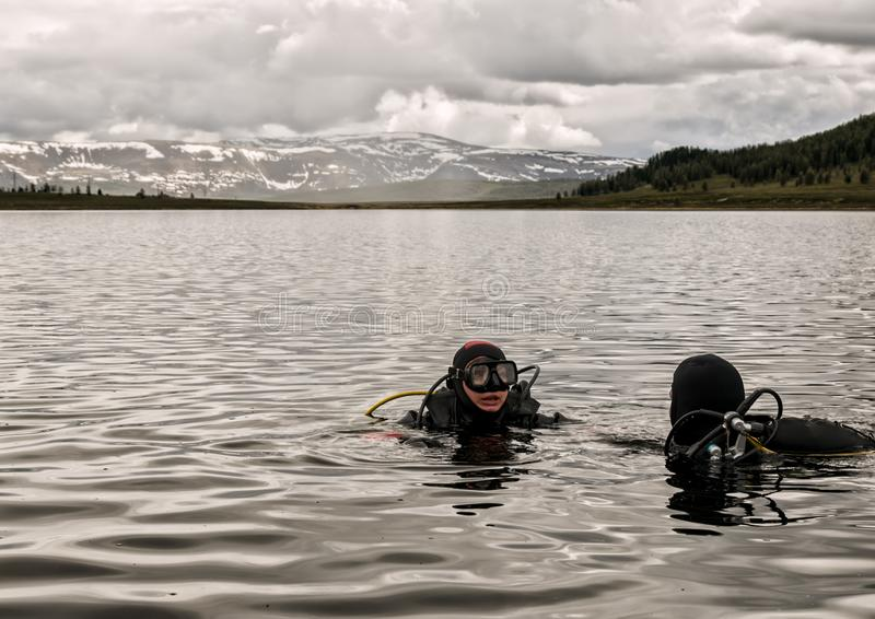 Scuba diving in a mountain lake, practicing techniques for emergency rescuers. immersion in cold water royalty free stock photography
