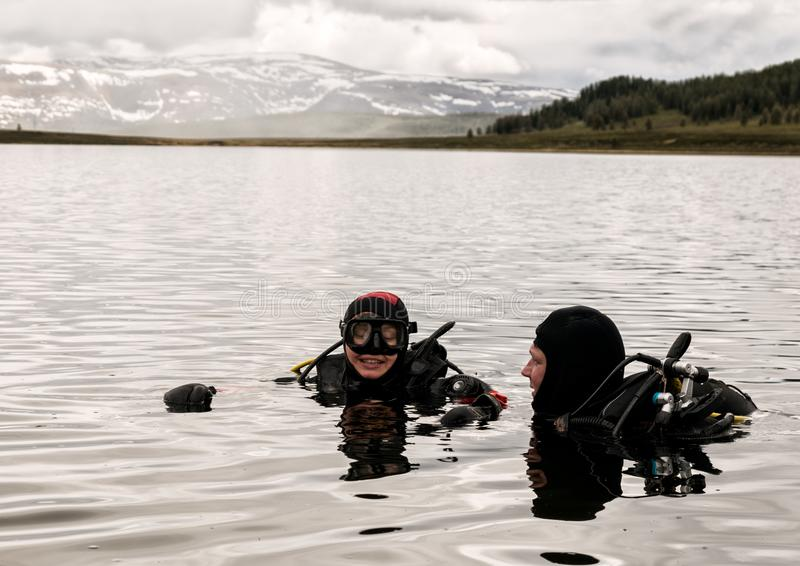 Scuba diving in a mountain lake, practicing techniques for emergency rescuers. immersion in cold water stock images